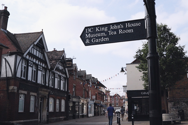 Signpost in Romsey Town Centre, Tourist Sign showing King John's House, Museum, Tea Room and Garden